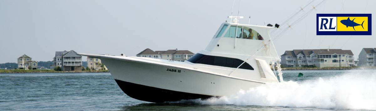 Boat named Jade II speeding in water in front of condos